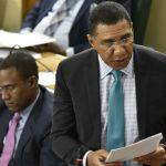 Jamaican Prime Minister, Andrew Holness, speaking during yesterday's (April 16) sitting of the House of Representatives. Listening is Finance and the Public Service Minister, Dr. Nigel Clarke. Photo credit: Donald De La Haye/JIS.