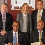 At the MoU signing were: Professor Sir Hilary Beckles, Vice-Chancellor of The UWI (front right); Gervan Fearon, President and Vice-Chancellor of Brock University (front left); and back row, from left to right: James Mandigo, Brock's Vice-Provost, Enrolment Management and International; Laurie Peters, Canada's High Commissioner to Jamaica, Bahamas, Turks and Caicos, and Cayman Islands; and Richard Bernal, UWI Pro-Vice-Chancellor for Global Affairs.