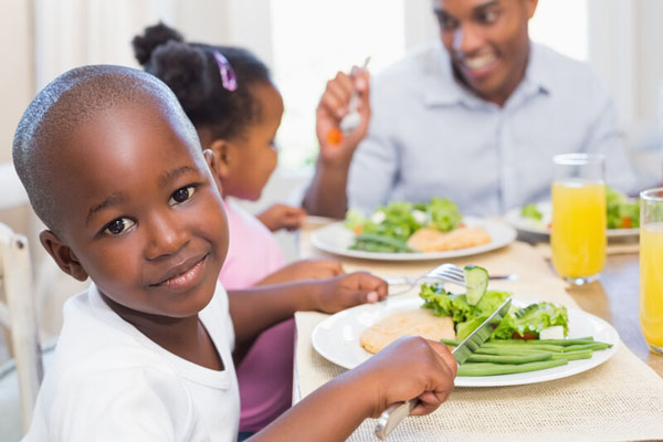 When Dad eats vegetables, so do the kids. Photo credit:  (c) Can Stock Photo / 4774344sean