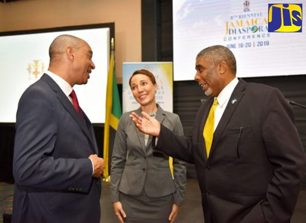 Foreign Affairs and Foreign Trade Minister, Senator Kamina Johnson Smith (centre), listens to a discussion between Government Senator and GraceKennedy Limited Chief Executive Officer, Don Wehby (left), and Jamaica National Group Assistant General Manager, Leon Mitchell, during the official launch of the eighth biennial Jamaica Diaspora Conference. Photo credit: Yhomo Hutchinson/JIS.