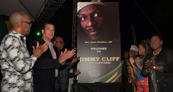 THE BIG MOMENT: Patrons, who gathered at the Old Hospital Site in Montego Bay, St James, on Thursday, March 28, for the Civic Ceremony, to mark the renaming of Gloucester Avenue to Jimmy Cliff Boulevard, gave a loud cheer as the sign that will stand at the entrance to the thoroughfare was unveiled. From right to left are: Minister of Culture, Gender, Entertainment and Sport, Olivia Grange; Jimmy Cliff's daughter, Lilty; and the man of the moment, Jimmy Cliff. Sharing in the moment, from left to right, are: Charles Sinclair, who represented Dr. Horace Change, Minister of National Security and MP for North West St. James; Councillor, Homer Davis, Mayor of Montego Bay; and Minister of Tourism, Edmund Bartlett, who shared in the moment. Photo contributed.