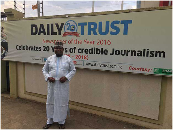 Nurudeen Abdallah, investigations editor of the Daily Trust, pictured outside the newspaper's headquarters in Abuja. The paper was raided by the military in January. Photo credit: CPJ/Jonathan Rozen.