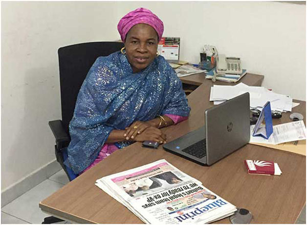 Zainab Suleiman Okino sits at her desk in the Blueprint office in Abuja. Photo credit: CPJ/Jonathan Rozen.
