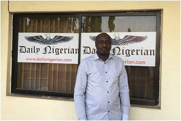 Jaafar Jaafar, of the Daily Nigerian, pictured outside the office of his newspaper in Abuja. Photo credit: CPJ/Jonathan Rozen.