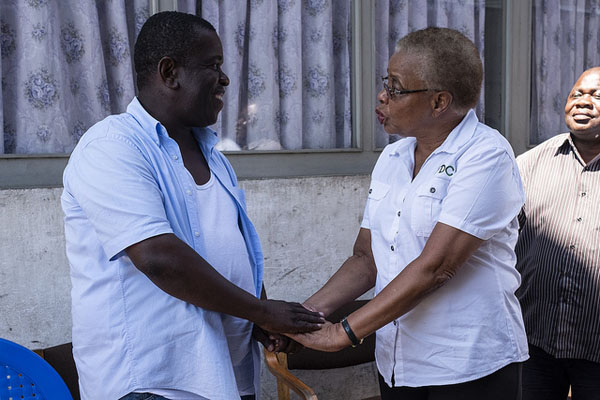 Former Mozambique First Lady, Graca Machel (right), the Chair of the FDC (Foundation for Community Development), speaks to Davis Simango (left), Mayor of Beira, at a government facility that was damaged during Cyclone Idai. Photo credit: UNICEF.