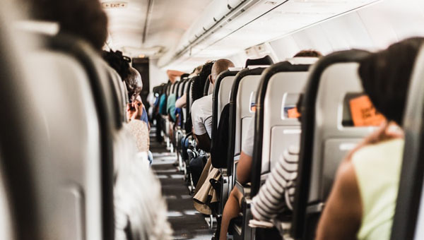 Air Travel Spreads Infections Globally, But Health Advice From In-Flight Magazines Can Limit That