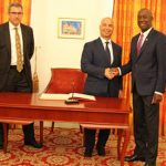 Trinidad and Tobago Prime Minister, Dr. Keith Rowley (second from right), greets Nutrien President and CEO, Chuck Magro. To the prime minister's right is the twin-island's Security Minister, Stuart Young.