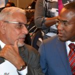 Finance and the Public Service Minister, Dr. Nigel Clarke (right), in dialogue with Mona School of Business and Management (MSBM) Executive in Residence, James Moss-Solomon, during the opening ceremony for the MSBM's three-day business and management conference, at The Jamaica Pegasus hotel in New Kingston, on Wednesday. Photo credit: Mark Bell/JIS.