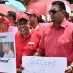 Guyana's main opposition Presidential candidate, Irfaan Ali (in shades), pictured leading demonstrators against plans by GECOM for house-to-house registration.