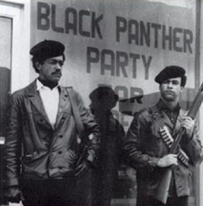 The fashion trendsetting Black Panther Party (BPP) -- originally the Black Panther Party for Self-Defense -- was a revolutionary political organization founded by Bobby Seale (left) and Huey P. Newton, pictured standing in the street, armed with a Colt .45 and a shotgun.