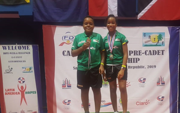 Azizi Johnson and Tsenaye Lewis display their medals. Photo contributed.