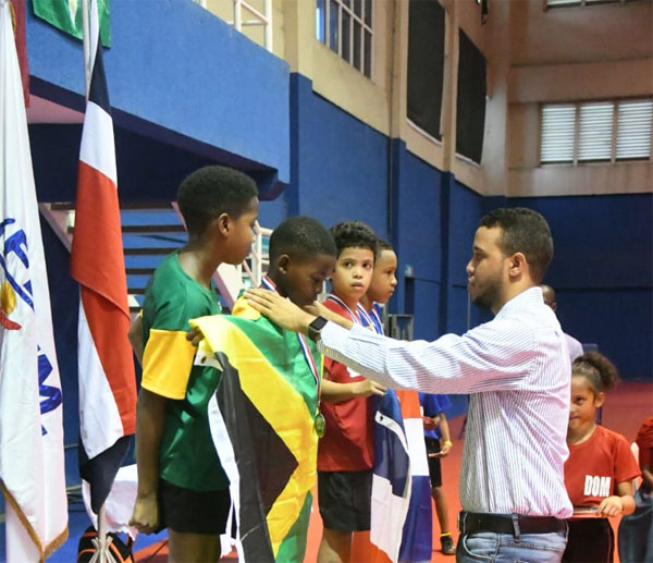 Gari Whyte and Nickoy Smith seen receiving bronze medals. Photo contributed.