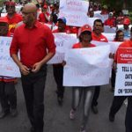 Guyana's main Opposition Leader, Bharrat Jagdeo (forefront), seen protesting with supporters of the People's Progressive Party-Civic, yesterday.