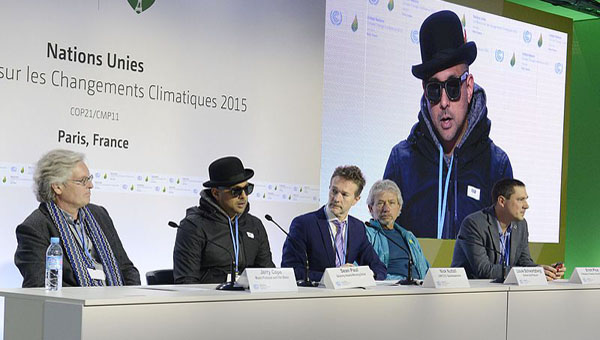 Sean Paul (second from left) speaking at the 2015 United Nations Climate Change Conference. Photo by Hajue Staudt / UNclimatechange, CC BY 2.0, https://commons.wikimedia.org/w/index.php?curid=48972275.