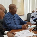 Guyana's Finance Minister, Winston Jordan (center), seen presenting the government's mid-year economic review.