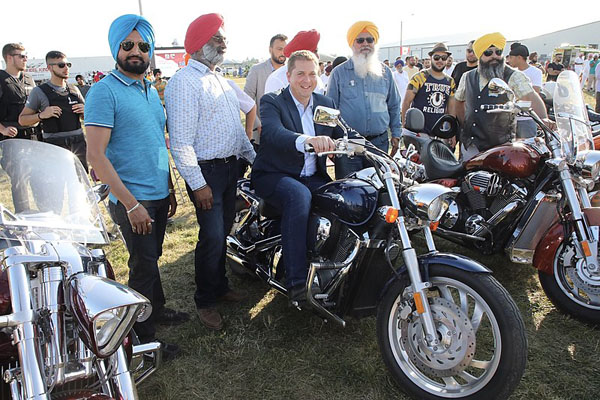 Andrew Scheer at Brampton's Canada Day Mela celebrations in 2018. Photo by Andrew Scheer - https://www.flickr.com/photos/andrewscheer/28306492727/, CC0, https://commons.wikimedia.org/w/index.php?curid=70550752