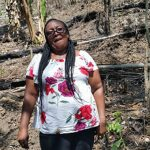 Jamaican rural farmer, Joan Johnson, on her property.