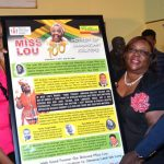 Permanent Secretary in the Ministry of Culture, Gender, Entertainment and Sport, Denzil Thorpe (right); and National Librarian, National Library of Jamaica (NLJ), Beverley Lashley (second right), receive the special Miss Lou storyboard from Special Projects Officer, Fontana Pharmacy, Stephanie Smith. Occasion was the Unlocking the Miss Lou Archives on Thursday, September 12 at the NLJ, East Street in Kingston. The event formed part of national activities to commemorate the 100th anniversary of the birth of cultural icon, Dr. Louise Bennett Coverley. Photo credit: Mark Bell/JIS.