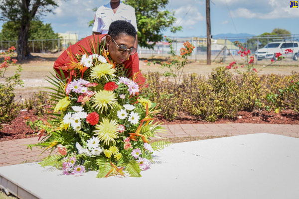 Minister of Culture, Gender, Entertainment and Sport, Hon Olivia Grange, lays flowers at the resting place of Dr. Louise Bennett Coverley, at National Heroes Park, Kingston, during a ceremony on Saturday (September 7) to commemorate the 100th anniversary of the birth of the cultural icon. Photo credit: Adrian Walker/JIS.
