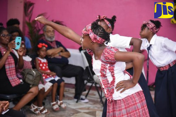 Students of the Louise Bennett Coverley All-age School in St. Andrew perform one of the late cultural icon's poems at her 100th birthday anniversary celebration and cake cutting ceremony, held at the Gordon Town Community Centre, on September 8.