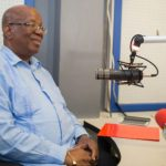 Guyana's Finance Minister, Winston Jordan, making the announcement on a local radio program. Photo credit: DPI.