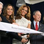 Beyoncé (center) is flanked by her mother, Tina Knowles, (second from left) and then New York Mayor, Billionaire Michael Blumberg (second from right), at the opening of the Beyoncé Cosmetology Center on March 5, 2010. The others in the photo are BP Markowitz, left, and Karen Carter, right .Photo credit: dumbonyc - Beyonce, CC BY-SA 2.0.