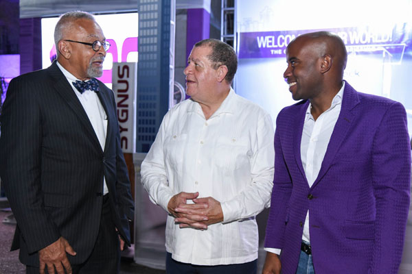 Industry, Commerce, Agriculture and Fisheries Minister, Audley Shaw (centre), in discussion with Co-founder of First Rock Capital Holdings Limited, Dr. Michael Bambury (left), during an Initial Public Offering (IPO) investor briefing at 5 Seaview Avenue in St. Andrew on January 9. Looking on is Co-founder and President, Ryan Reid. Photo credit: Adrian Walker/JIS.