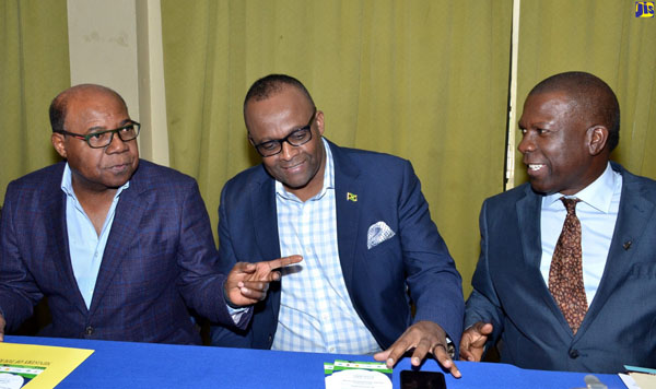 Tourism Minister, Edmund Bartlett (left), converses with Tourism Director, Donovan White (centre), and Chairman of the Jamaica Coffee Exporters Association, Norman Grant, during Thursday's launch of the third annual Jamaica Blue Mountain Coffee Festival. Photo credit: Mark Bell/JIS.