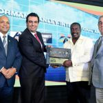 Minister of Transport and Mining, Robert Montague (second right), symbolically hands over the key to the Norman Manley International Airport (NMIA) to CEO of Grupo Aeroportuario del Pacifico (GAP), Raul Revuelta (second left), last October. GAP has taken over the operations of the airport, under a 25-year concession agreement, through its local subsidiary, PAC Kingston Airports Limited (PACKAL). Sharing the moment (from left) are: CEO of Airports Authority of Jamaica (AAJ), Audley Deidrick and AAJ Chairman, William Shagoury. Photo credit: Adrian Walker/JIS.
