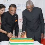 India's High Commissioner, Dr. Kotehal Jayadevappa Srinivasa (second from left), and President, David Granger, cut the cake to celebrate India's 70th anniversary as a Republic. Looking on is Moses Nagamootoo, Guyana's Prime Minister.