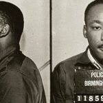 Lest we forget: Dr. Martin Luther King was arrested in 1963 for protesting the treatment of Blacks in Birmingham. Photo credit: Birmingham, AL police dept -- Public domain.