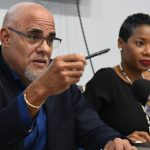 Private Sector Organisation of Jamaica (PSOJ) President, Keith Duncan (left), responds to questions from journalists during yesterday's launch of the PSOJ's 2020-2022 Strategy. At right is PSOJ Chief Executive Officer, Makeba Bennett-Easy. Photo credit: Michael Sloley/JIS.