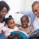 Parents instilling a love of books in their children. Photo credit:  (c) Can Stock Photo / 4774344sean