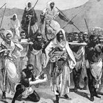 19th-century engraving, depicting an Arab slave-trading caravan transporting Black African slaves across the Sahara. Credit: 19th-century engraving, uploaded by DavidYork71 at en.wikipedia; Public Domain.