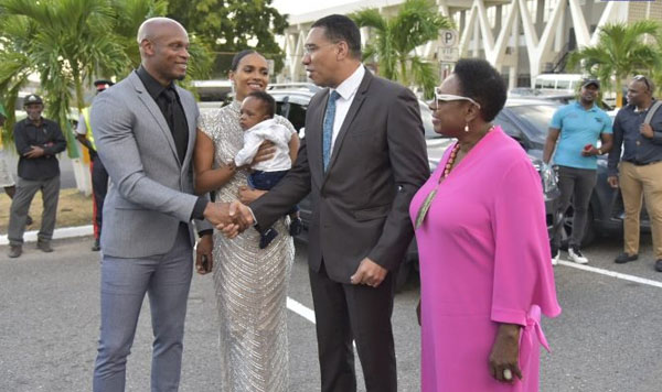 Asafa Powell, his wife, Alyshia Powell, and their son, Amieke Powell, is greeted by Prime Minister, Andrew Holness (second right) and Minister of Culture, Gender, Entertainment and Sport, Olivia Grange (right), at the unveiling of his statue at Statue Park, National Stadium, in Kingston. Photo credit: Donald De La Haye/JIS.