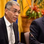 Bank Of Jamaica (Boj) Governor, Richard Byles (left), addresses journalists during Thursday's quarterly media briefing at the Boj in downtown Kingston. At right is Senior Boj Deputy Governor, John Robinson. Photo credit: Adrian Walker/JIS.