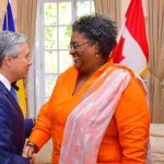Barbados Prime Minister, Mia Amor Mottley, greets Canada's Minister of Foreign Affairs, François-Philippe Champagne, at their courtesy call at Ilaro Court, today. Looking on is Barbados' Minister in the Ministry of Foreign Trade, Sandra Husbands (right). Photo credit: C.Pitt/BGIS.