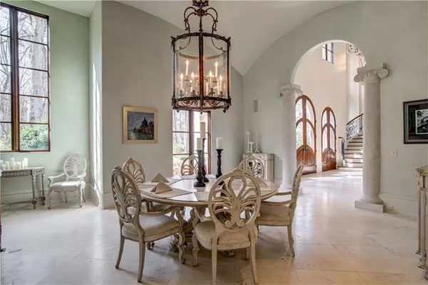 The dining space -- with columns, of course. Photo credit: Drone Media Solutions, via Dorsey Alston Realtors.