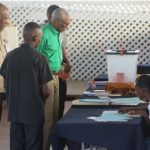 Guyana President, David Granger, dressed in green shirt, seen at one polling station, today. Photo credit: Guyana's Department of Public Information.