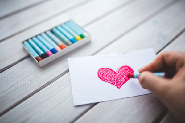 For younger children, crafting Valentine's Day cards develops an array of fine motor and literacy skills. Photo credit: Kaboompics .com/Pexels.