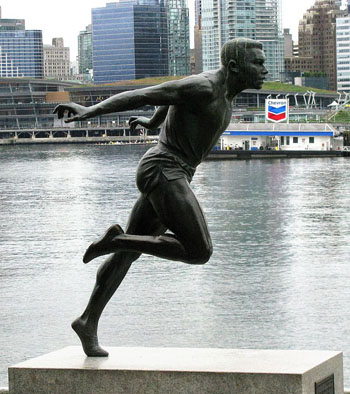 Statue in diagonal position showing Canadian athlete, Harry Jerome, running, located on the waterfront by Stanley Park, Vancouver, British Columbia, Canada. Photo credit: Laurent Bélanger - Own work, CC BY-SA 4.0.
