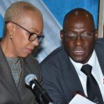Minister of Science, Energy and Technology, Fayval Williams (left), discusses an important aspect of a document with Principal Director for Energy in the Ministry, Fitzroy Vidal. Occasion was a press conference held at the Trafalgar Road offices of the Petroleum Corporation of Jamaica (PCJ), yesterday. Photo credit: Mark Bell/JIS.