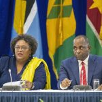 CARICOM Chair and Barbados' Prime Minister, Mia Amor Mottley, explains some of the outcomes of the 31st Inter-sessional CARICOM Meeting. Looking on is Dominica's Prime Minister, Roosevelt Skerritt. Photo credit: C.Pitt/BGIS.