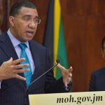 Prime Minister, Andrew Holness (left), speaks at a press conference at Jamaica House, on Monday. With the Prime Minister is Chief Medical Officer, Dr. Jacquiline Bisasor McKenzie. Photo credit: donald de la haye/JIS.