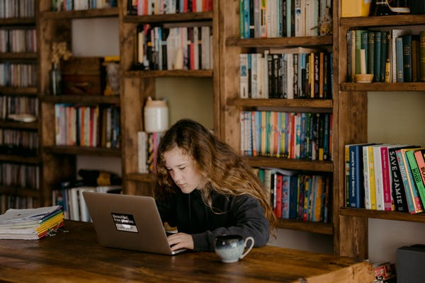 Some workers are home-schooling their kids while holding down jobs during the pandemic. Photo credit: Annie Spratt/Unsplash.