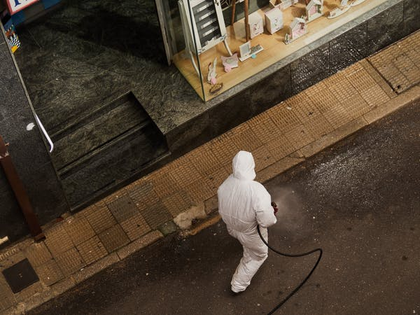 A Spanish street is disinfected due to the coronavirus outbreak. Photo credit: Unsplash.
