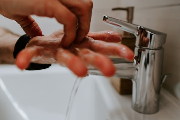 Think of hand washing as the new foreplay. Photo credit: Claudio Schwarz/Unsplash.