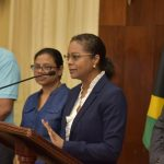 Prime Minister, Andrew Holness (right), listens as Attorney-General, Marlene Malahoo Forte (2nd right), speaks at a press briefing, last Friday, at the Office of the Prime Minister in Kingston. Looking on (from left) are: Minister of Health and Wellness, Dr. Christopher Tufton; and Chief Medical Officer, Dr. Jacquiline Bisasor-McKenzie. Photo credit: Donald De La Haye/JIS.