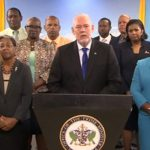 St. Lucia Prime Minister, Allen Chastanet (center), flanked by members of his Cabinet, addressing the nation. Photo credit: CMC.