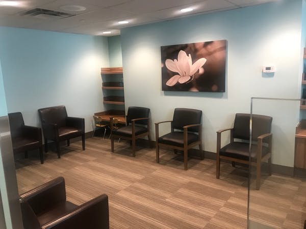 Social distancing changes made to Dr. Brenda Hardie's waiting room include, placing chairs six feet apart, and placing chairs between the receptionist desk and patients to prevent people from getting too close to the receptionist. Photo credit: Brenda Hardie; author provided.